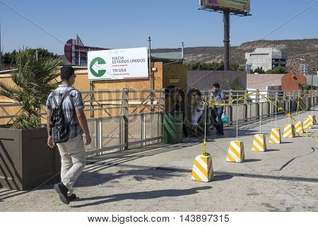 TIJUANA MEXICO - AUGUST 20 2016: During construction a temporary access is open from the Tijuana River pedestrian bridge to the new San Ysidro Port of Entry known as PedWest.