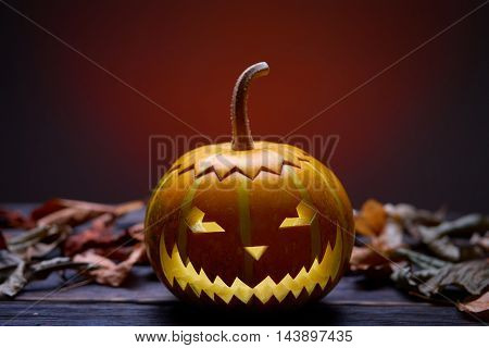 Pumpkin for Halloween, lamp pumpkin, antique wood, celebrating halloween, smiley on a pumpkin, autumn dry leaves, bright background