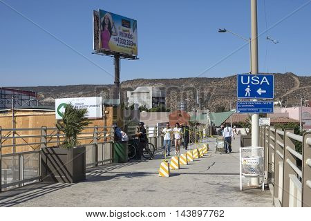 TIJUANA MEXICO - AUGUST 20 2016: Travelers returning from Tijuana can now use the temporary walkway to the new San Ysidro port of entry PedWest facility when going to the United States.
