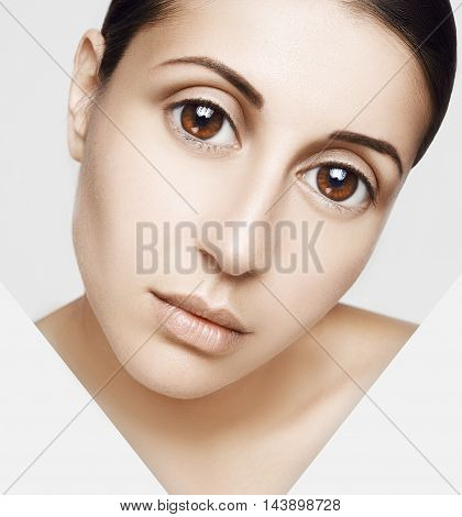 Beauty Woman face Portrait. Beautiful Spa model Girl with Perfect Fresh Clean Skin. Youth and Skin Care Concept. Isolated on a white background