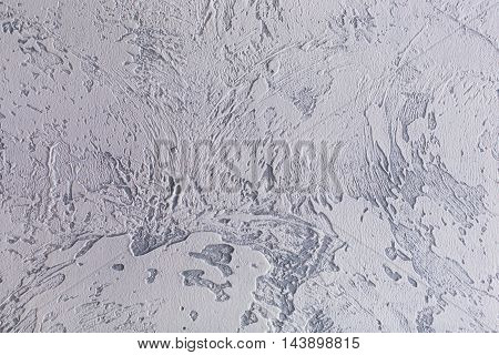 Gray plaster abstract textured uneven wall background