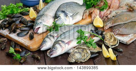 Raw Seafood On Wooden Board.