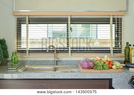 Vegetables on marble worktop in the kitchen