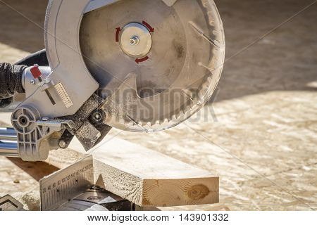 Circular saw is located on the construction site