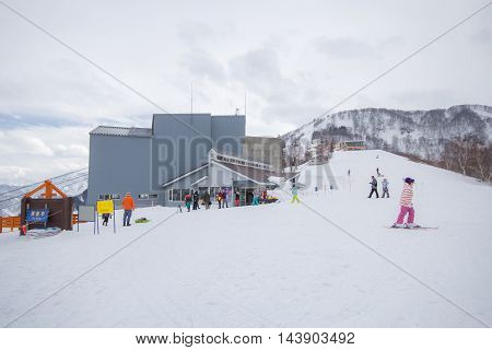YUZAWA , JAPAN - FEBRUARY 27,2014: Yuzawa is one of the main ski and snowboard towns in Japan, a snow paradise hosting over 6 million skiers and snowboarders per year.