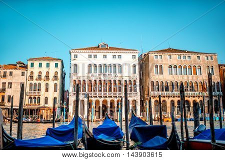 Venice cityscape view on Grand canal with colorful buildings and gondolas