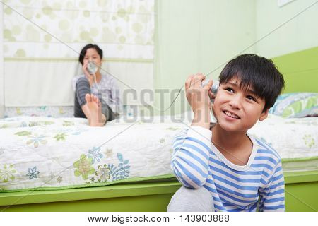 Preteen kids playing with can phone at home