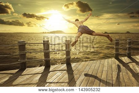 Cliff Jumping into the Ocean at Sunset Summer Fun Lifestyle