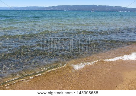 Crystal-clear waves on the shore of south Lake Tahoe, California Sierra Nevada Mountains