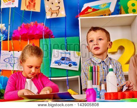 Boy and girl children mold from plasticine in school. Children in primary school. Development of children's creativity.