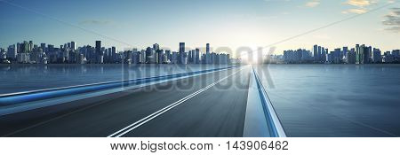 Highway overpass motion blur with city skyline background . cold mood . horizontal.