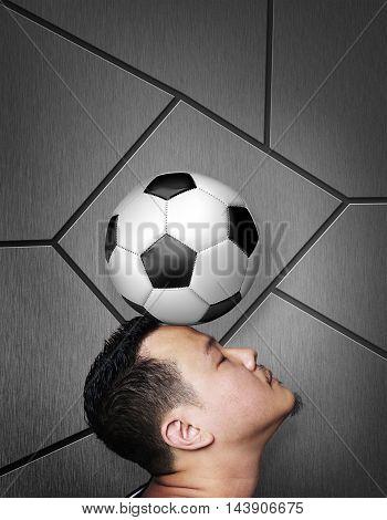Portrait of footballer balancing a ball on his head