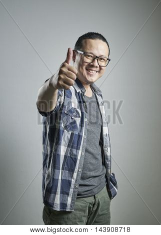 Asian japanese man doing a thumb up