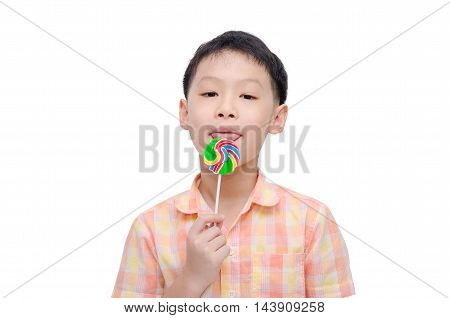 Young asian boy with lollipop over white background