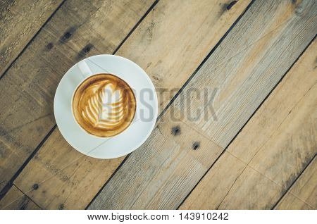 Top view of coffee cup on wooden table