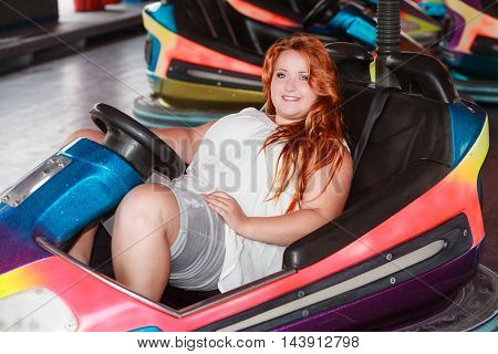 Trendy woman with oversize and red curls with a summer casual wear