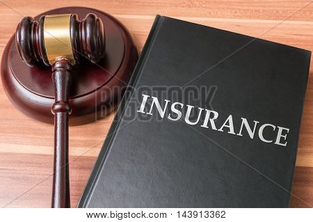 Book With Insurance Laws. Justice And Legislation Concept.
