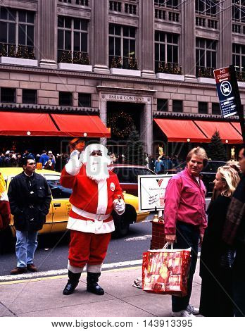 NEW YORK, UNITED STATES - DECEMBER 09, 1994 - Father Christmas along 5th Avenue at Christmas with Saks to the rear New York USA, December 9, 1994.