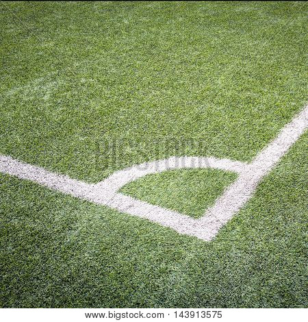 Football field corner with white marks green grass texture in soccer Field.