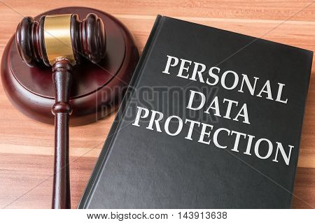 Personal data protection and security concept. Book and wooden gavel.