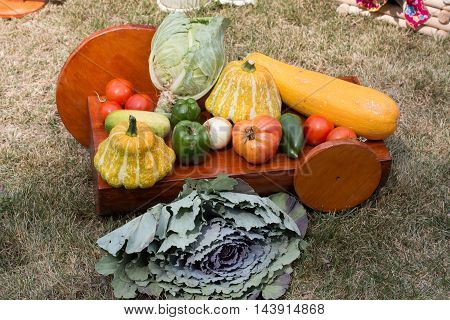 a fresh crop of vegetables lay in a heap on the trolley
