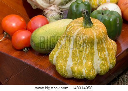 a fresh crop of vegetables lay in a pile on the table