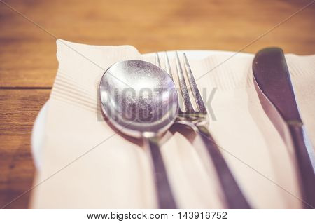 Vintage filter : Close up spoonforkknife on dinner table.