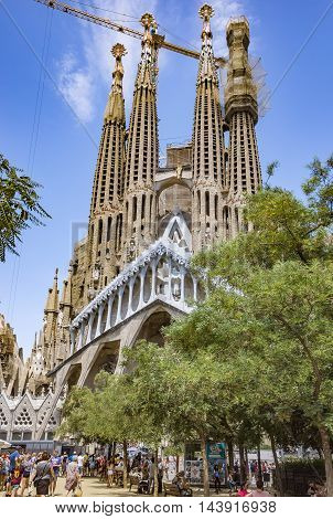 BARCELONA SPAIN - JULY 5 2016: La Sagrada Familia - the impressive cathedral designed by Gaudi which is being build since 19 March 1882 and is not finished yet