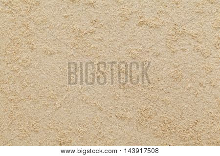 Organic dry powder of Ginger (Zingiber officinale) roots. Macro close up background texture. Top view.