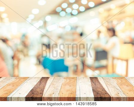 Empty Wood Table And Blurred Cafe Light Background. Business Presentation
