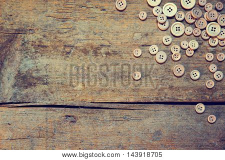 wooden vintage background with lot of buttons