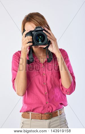 Confident real woman holding dslr camera, professional photographer