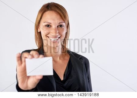 Woman business card showing towards camera isolated in studio