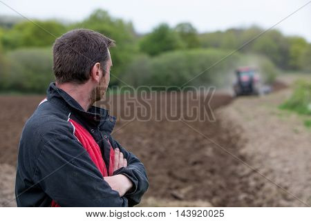 farmer showing his new tractor at work