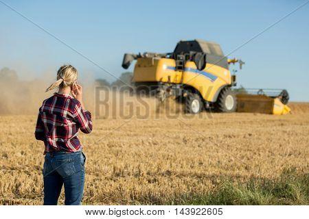 portrait of female farmer using electronics with sun