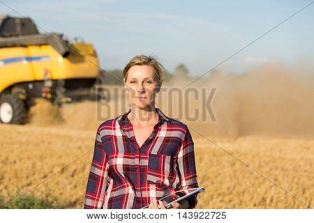 close up of female farmer in wheat field