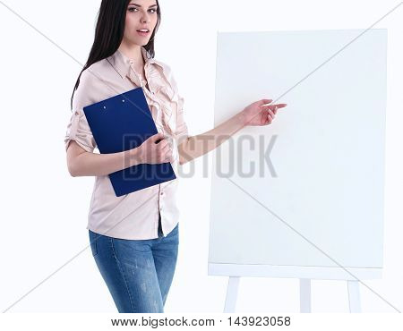 Portrait of a young businesswoman while presenting her project on board