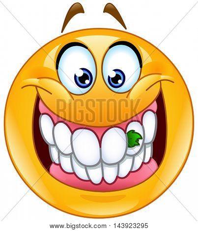 Yellow ball with food stuck between its teeth