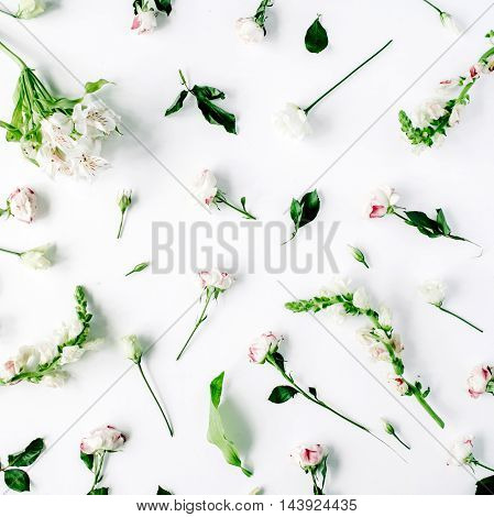 Wallpaper texture. Pink roses and white flowers on white background. Flat lay top view