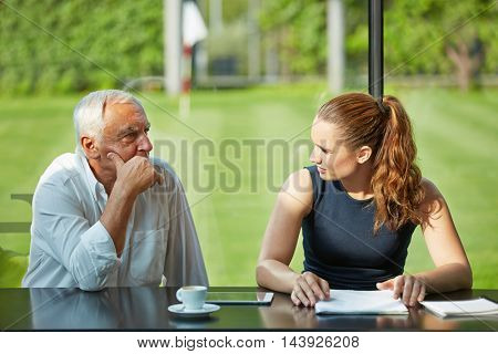 Pensive lawyer thinking near businesswoman in a meeting