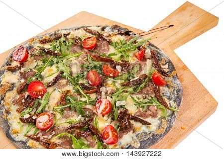 black pizza with smoked meat,tomatoes and basil isolated on white background