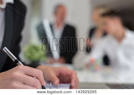 contract close up in big office with team
