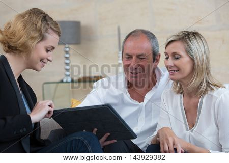 senior couple signing financial contract at home
