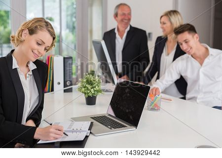 Portrait of a businesswoman using laptop in office