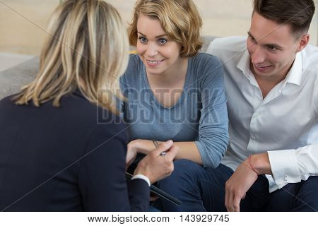 young Couple meeting consultant for financial contract