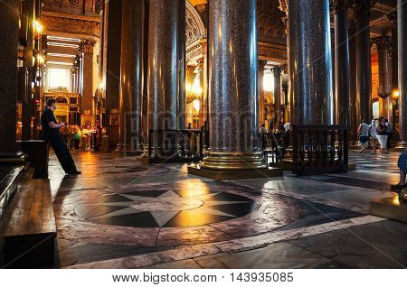 SAINT PETERSBURG, RUSSIA - JULY 7, 2012: Interior of Kazan Cathedral with people. The interior with columns features sculptures and icons of the best Russian artists.