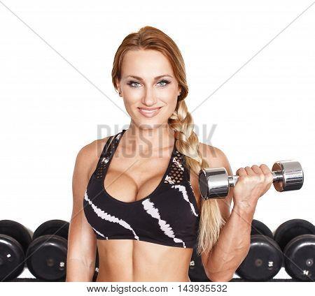 Female bodybuilder holding dumbbell isolated on white