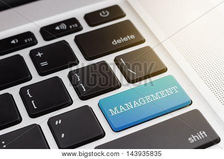 MANAGEMENT : Close up green button keyboard computer