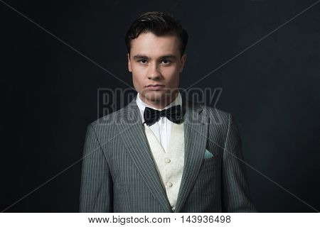 Well Dressed Retro 1920S Man With Bow Tie.