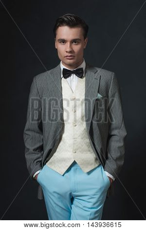 Retro 1920S Business Man In Suit With Bow Tie.